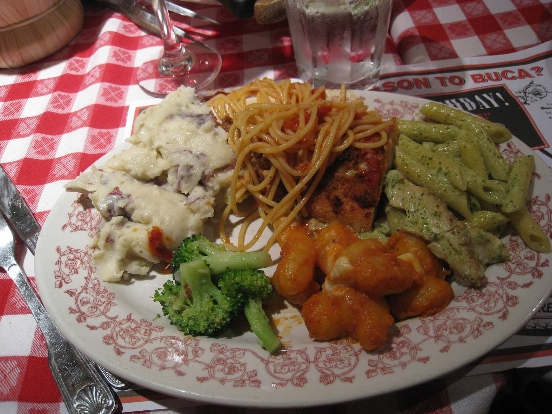 A plate full of food at Bucca di Beppo