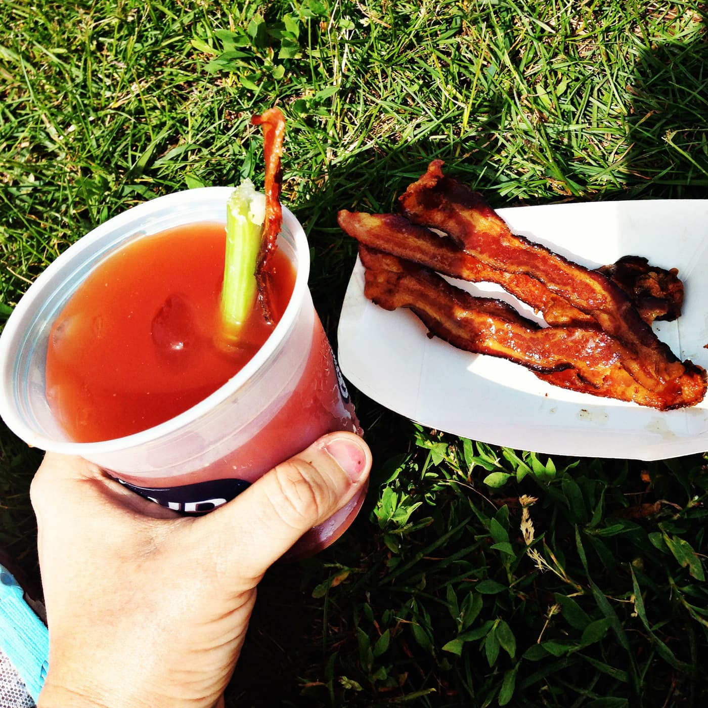 Bacon and a Bloody Mary at the finish line of the Bacon Chase 5K in Chicago, Illinois.
