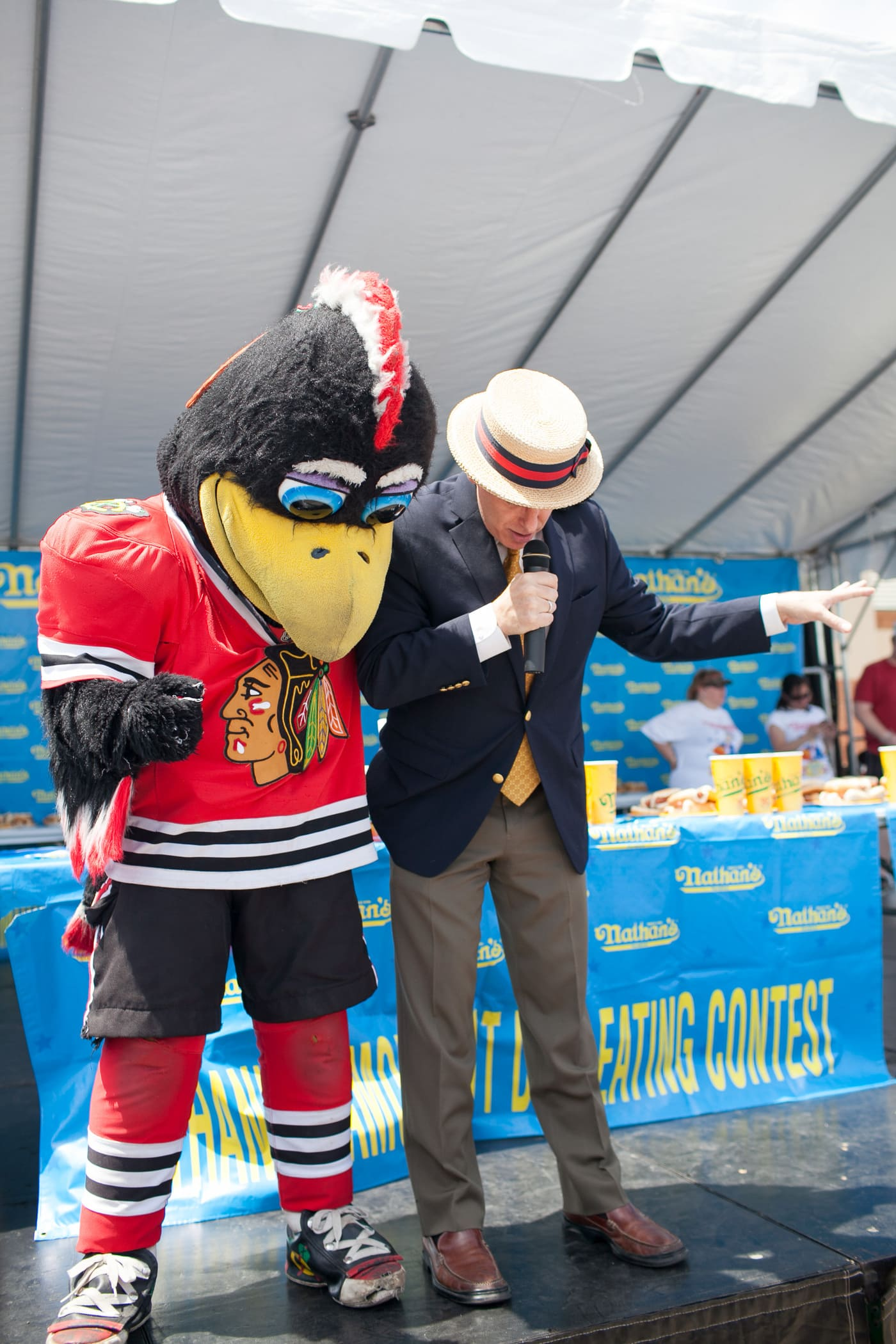 George Shea and Tommy Hawk introduce the hot dog eating contest at the Bloomingdale, Illinois, Kmart