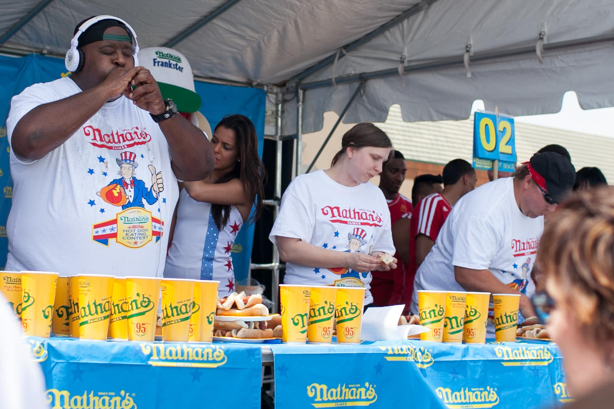 Eric Badlands Booker and Val Bromann eat at  the hot dog eating contest at the Bloomingdale, Illinois, Kmart