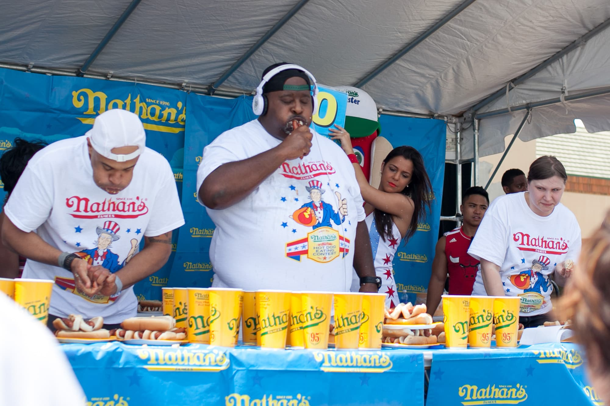 Eric Badlands Booker eats at the hot dog eating contest at the Bloomingdale, Illinois, Kmart