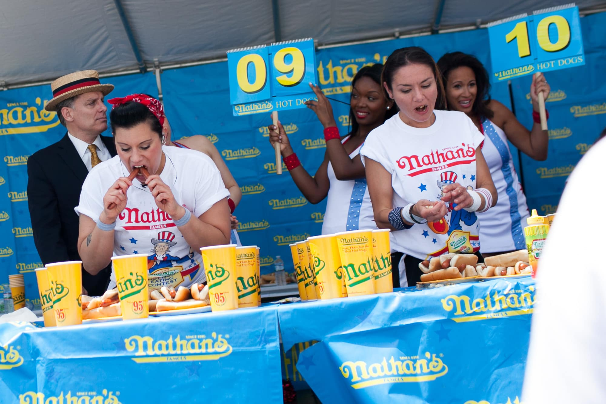 Nikki Rodriguez and Michelle Lesco eat at the hot dog eating contest at the Bloomingdale, Illinois, Kmart