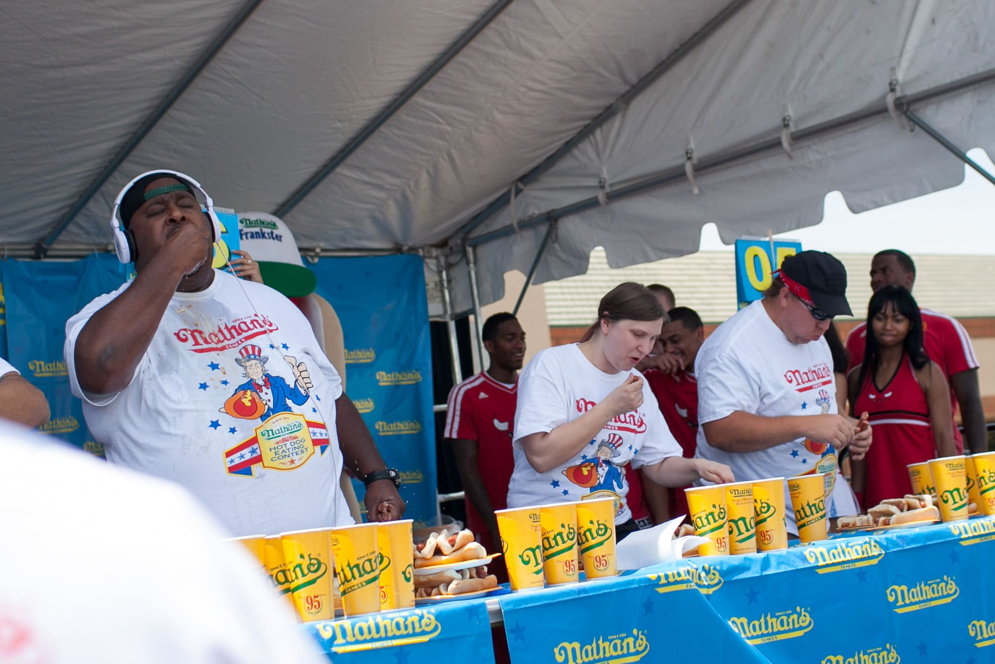 Competitive eaters eat hot dogs at the hot dog eating contest at the Bloomingdale, Illinois, Kmart