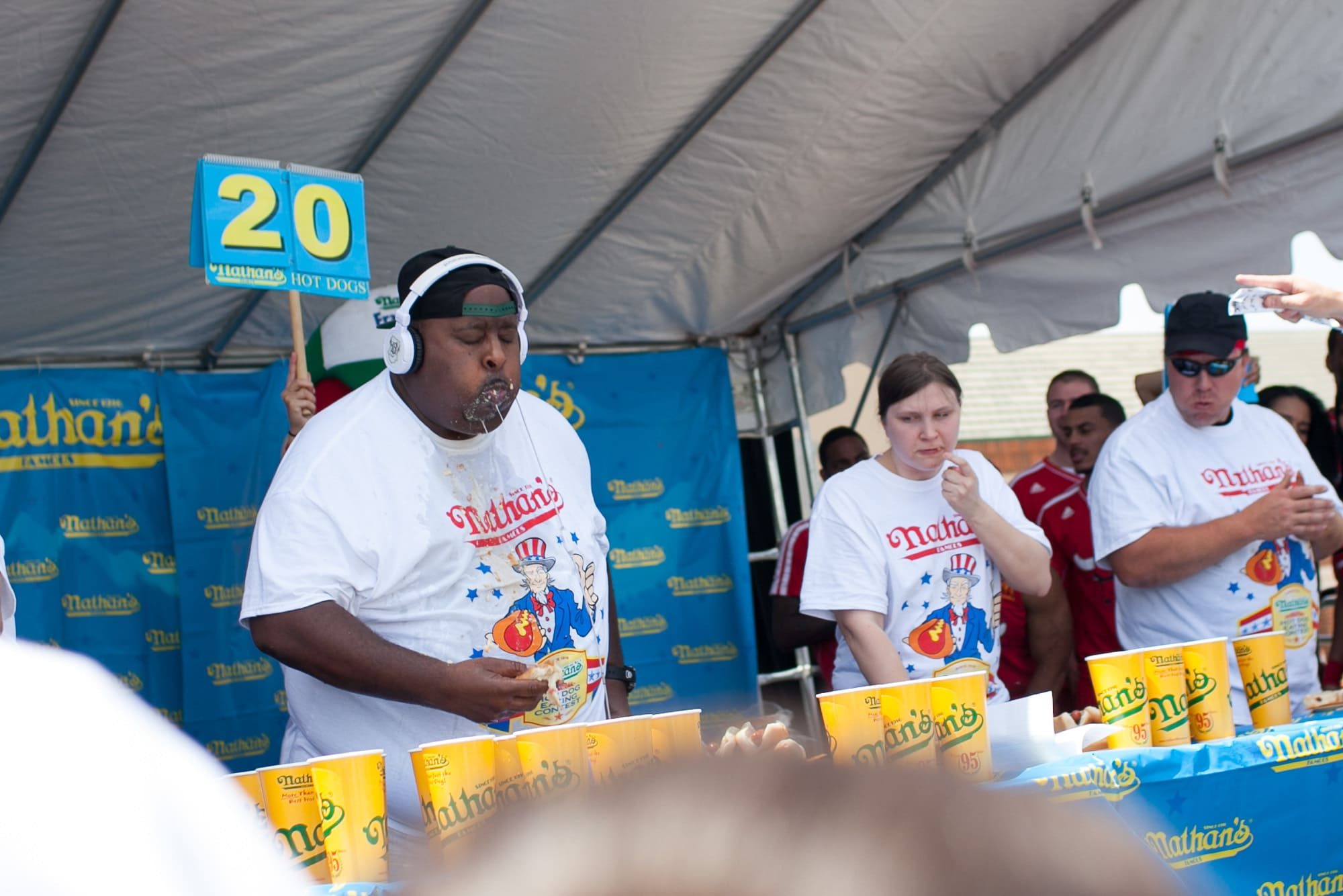 Competitive eaters at eat hot dogs at the hot dog eating contest at the Bloomingdale, Illinois, Kmart