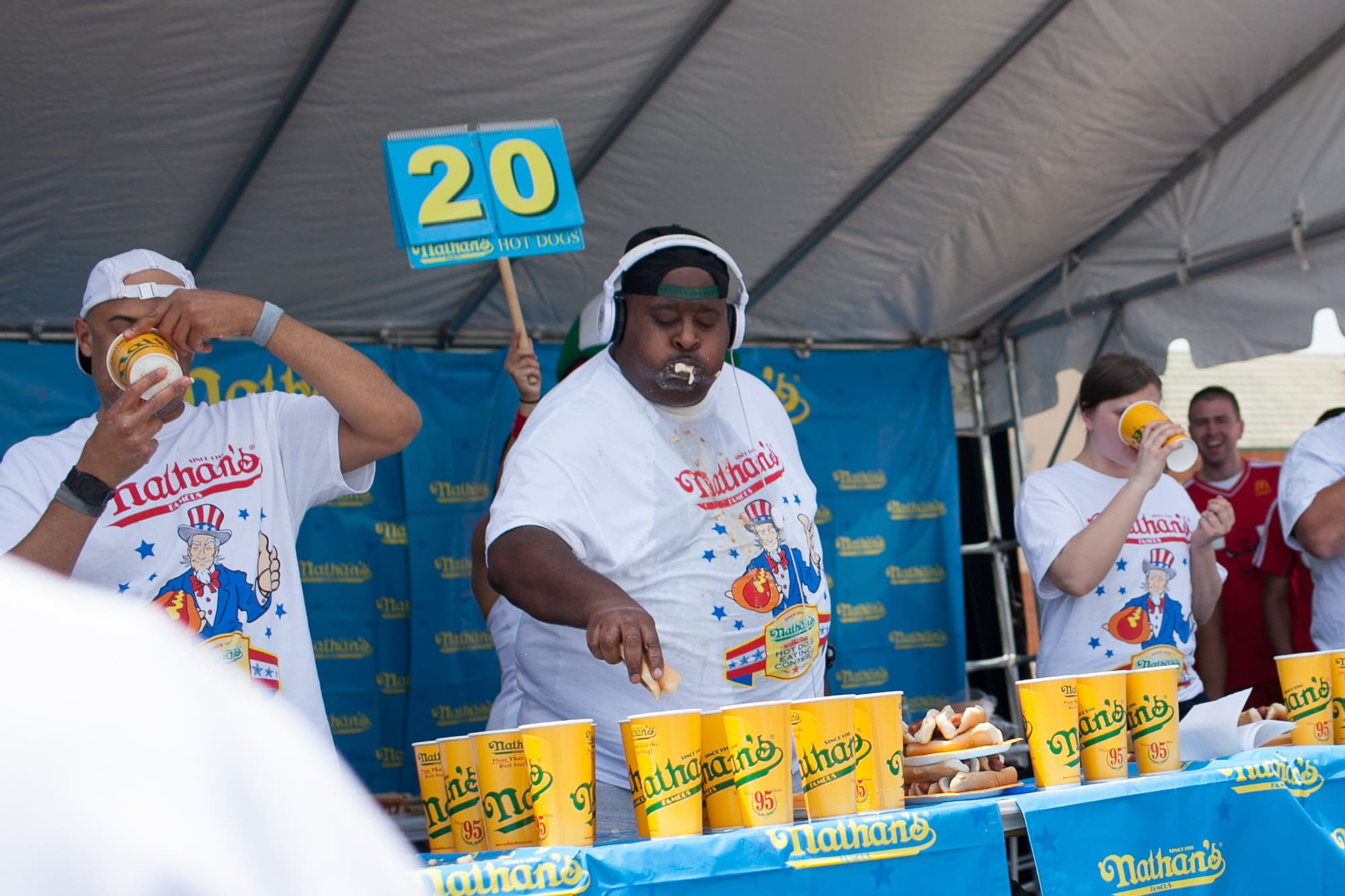 Eric Badland Booker eats at the Nathan's Famous hot dog eating contest qualifier at the Bloomingdale, Illinois, Kmart