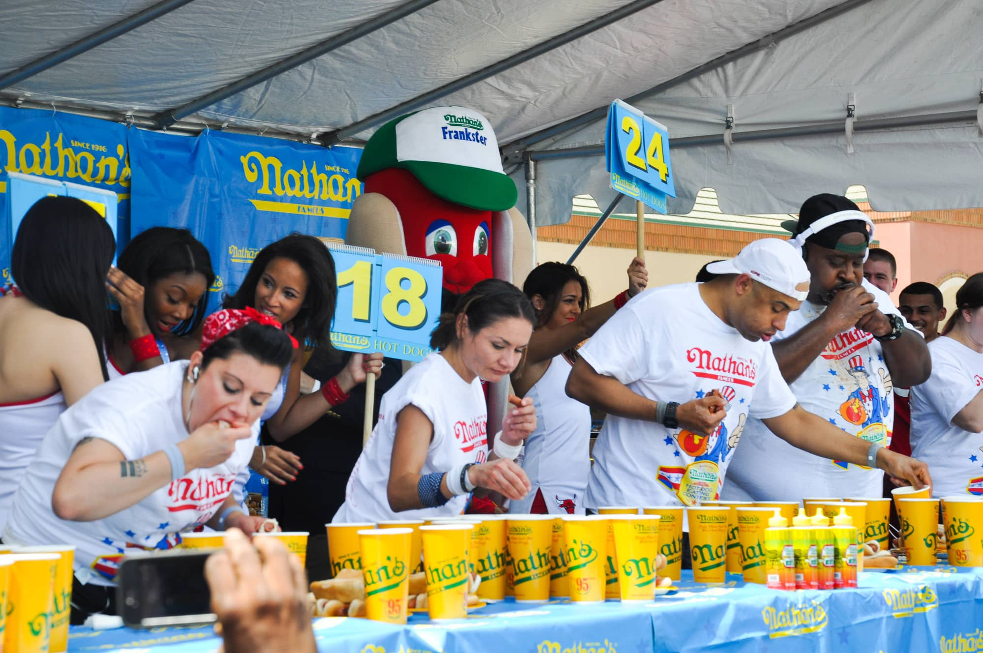 Competitive eaters at the table the hot dog eating contest at the Bloomingdale, Illinois, Kmart