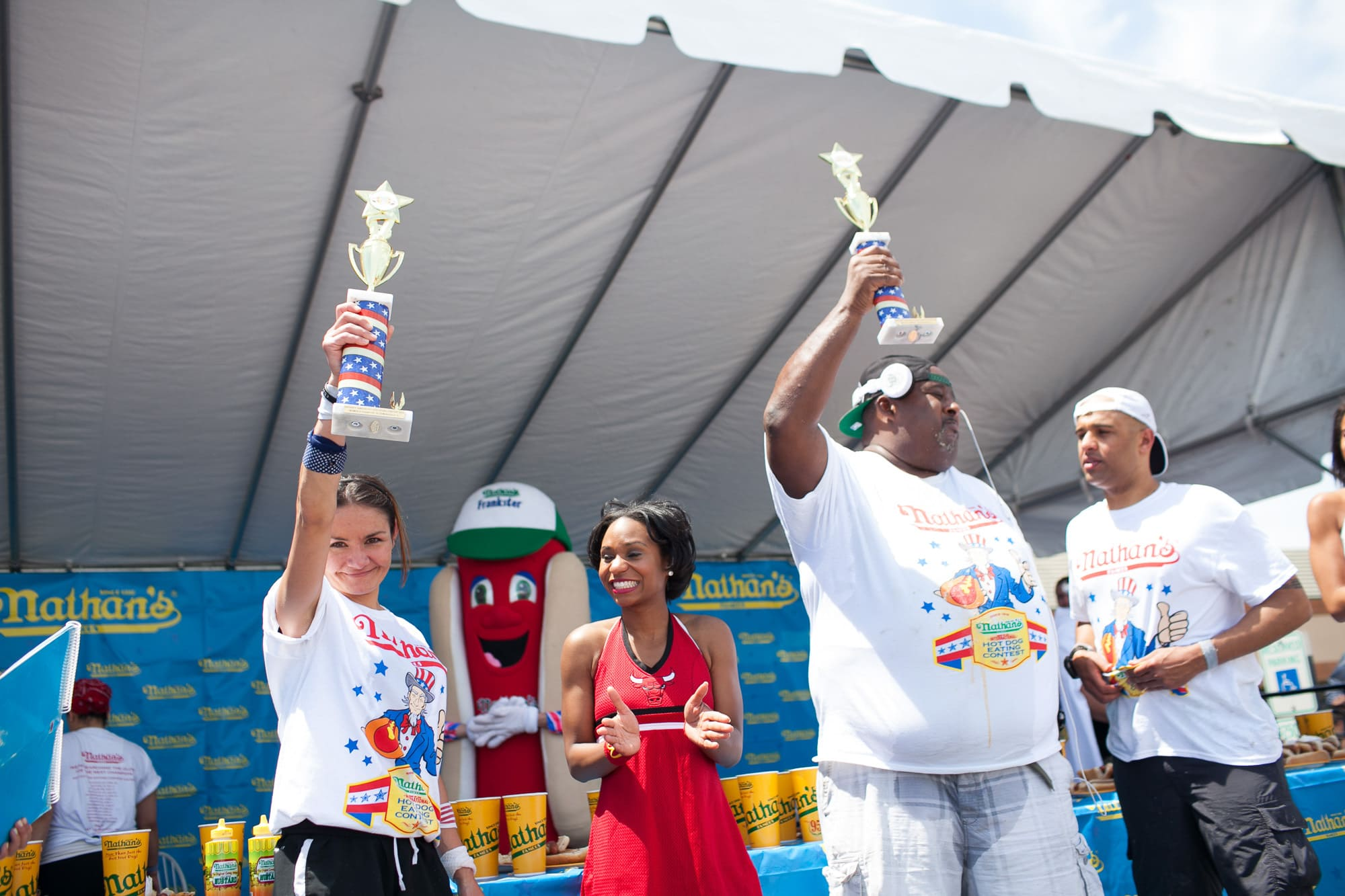 Michelle Lesco and Eric Badlands Booker win the hot dog eating contest at the Bloomingdale, Illinois, Kmart