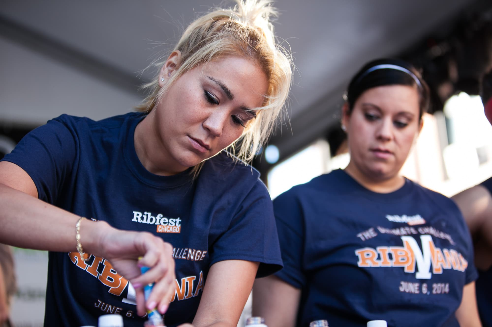 Miki Sudo prepares her drinks Ribmania Ribs Eating Contest at Ribfest Chicago.