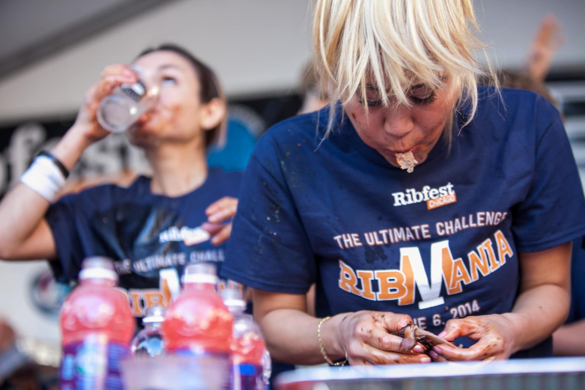 Miki Sudo and Michelle Lesco eat at Ribmania Ribs Eating Contest at Ribfest Chicago.