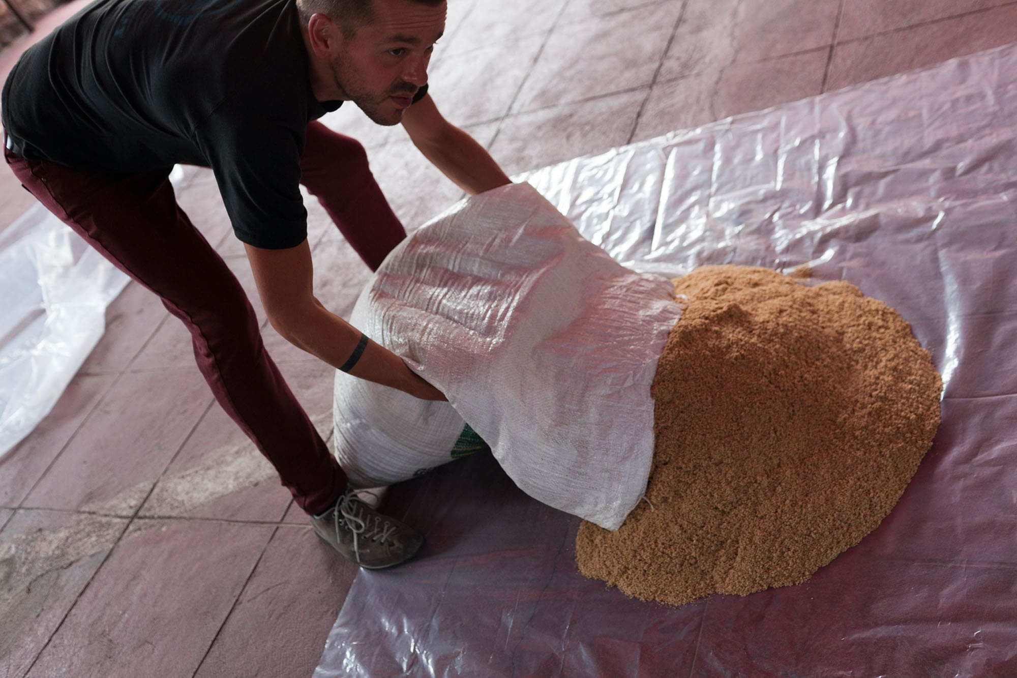 Dying sawdust to make an alfombra for Semana Santa in Antigua, Guatemala.