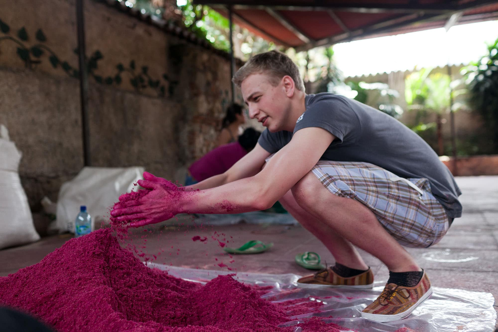 Dying sawdust to make an alfombra for Semana Santa in Antigua, Guatemala.