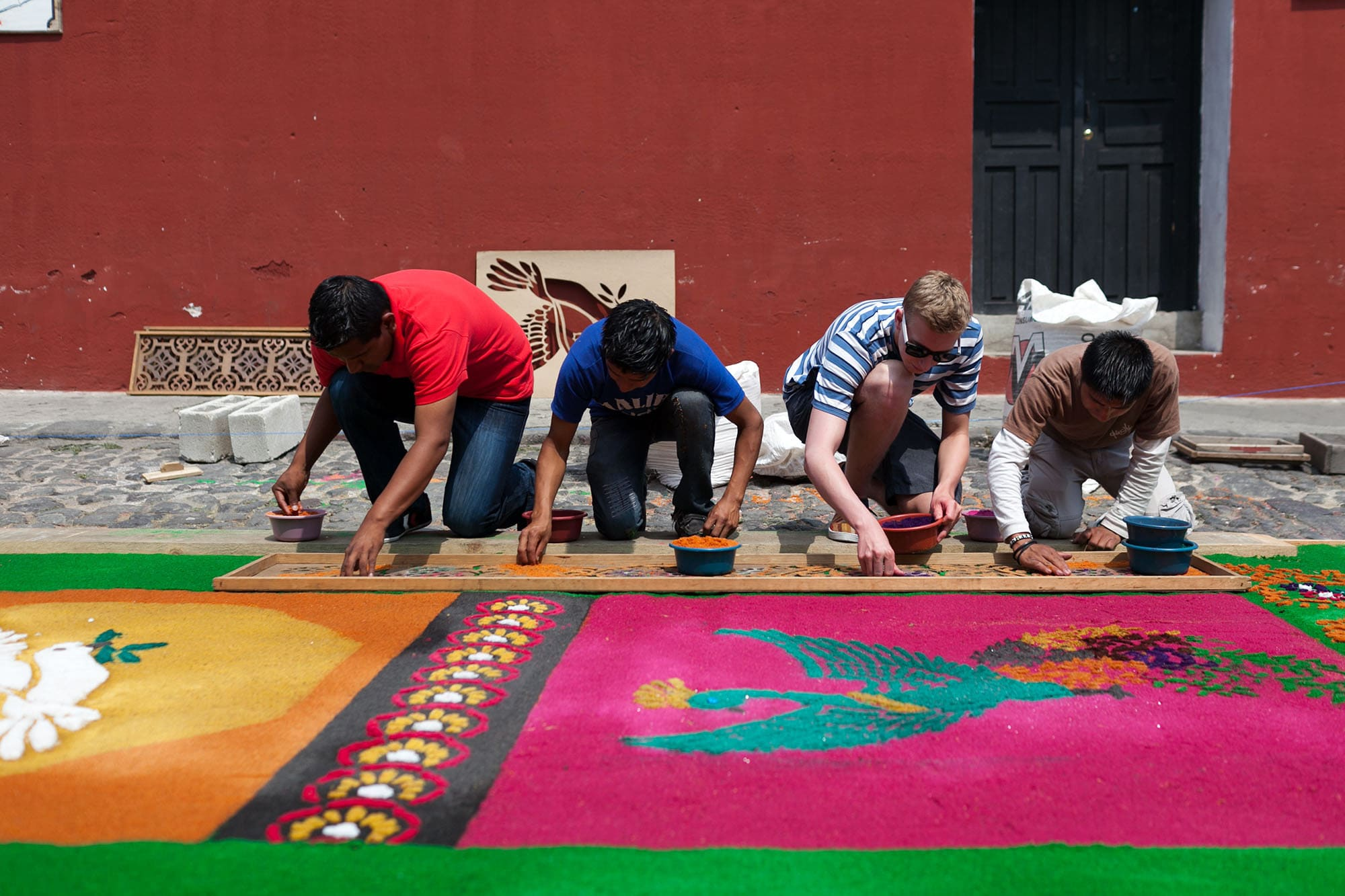 Creating an alfombra sawdust carpet for Semana Santa in Antigua, Guatemala.