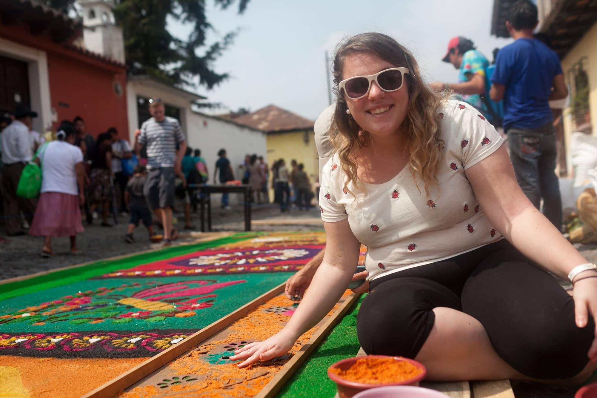 Creating an alfombra sawdust carpet for Semana Santa in Antigua, Guatemala.
