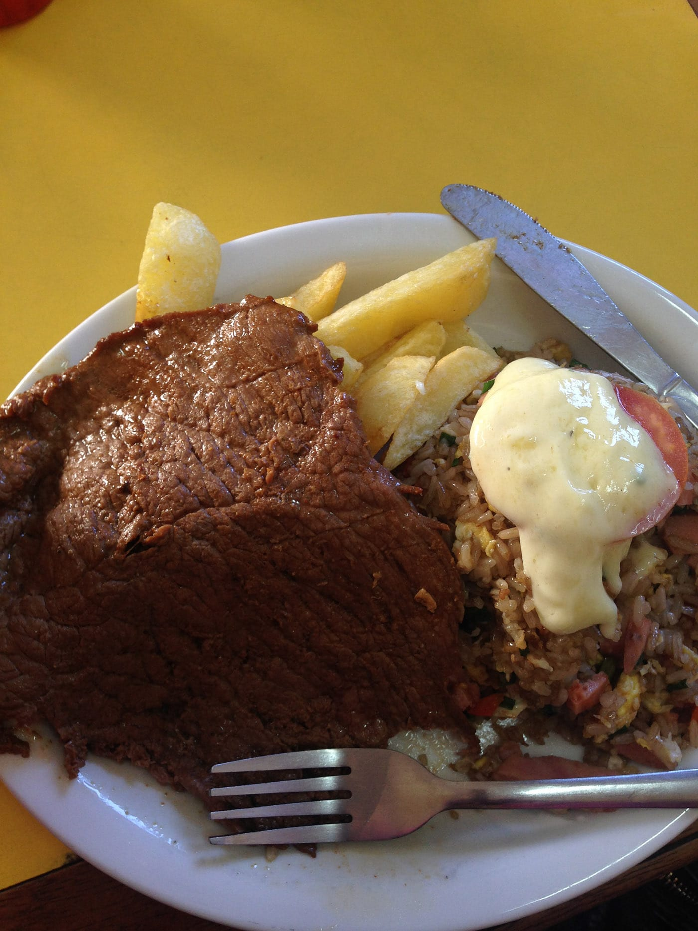 Beef with fried rice and fries in Cusco, Peru