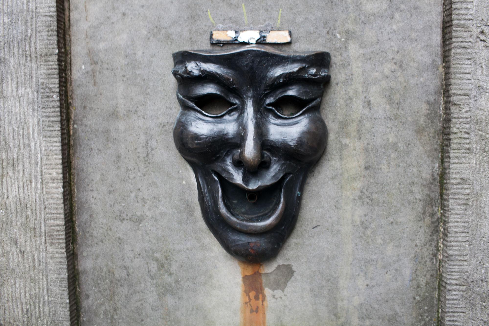 Comedy Mask on a post in Edinburgh, Scotland