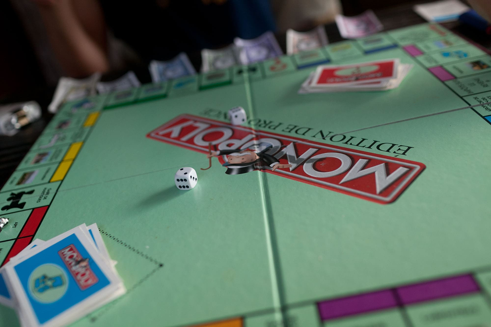 Playing the French version of Monopoly in El Nido, Palawan, Philippines
