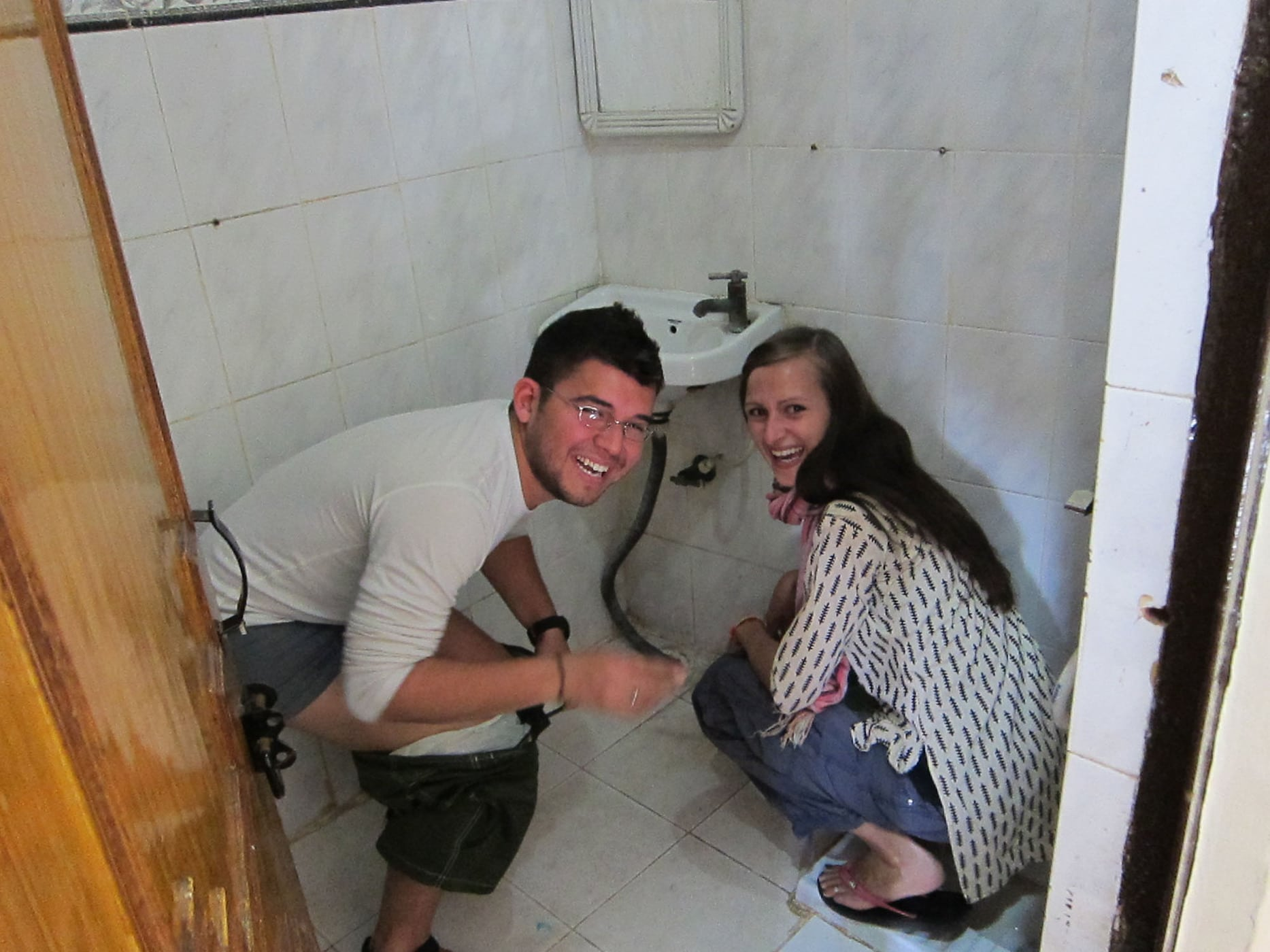 Teaching Jaime to use the squat toilet in Mathura, India.