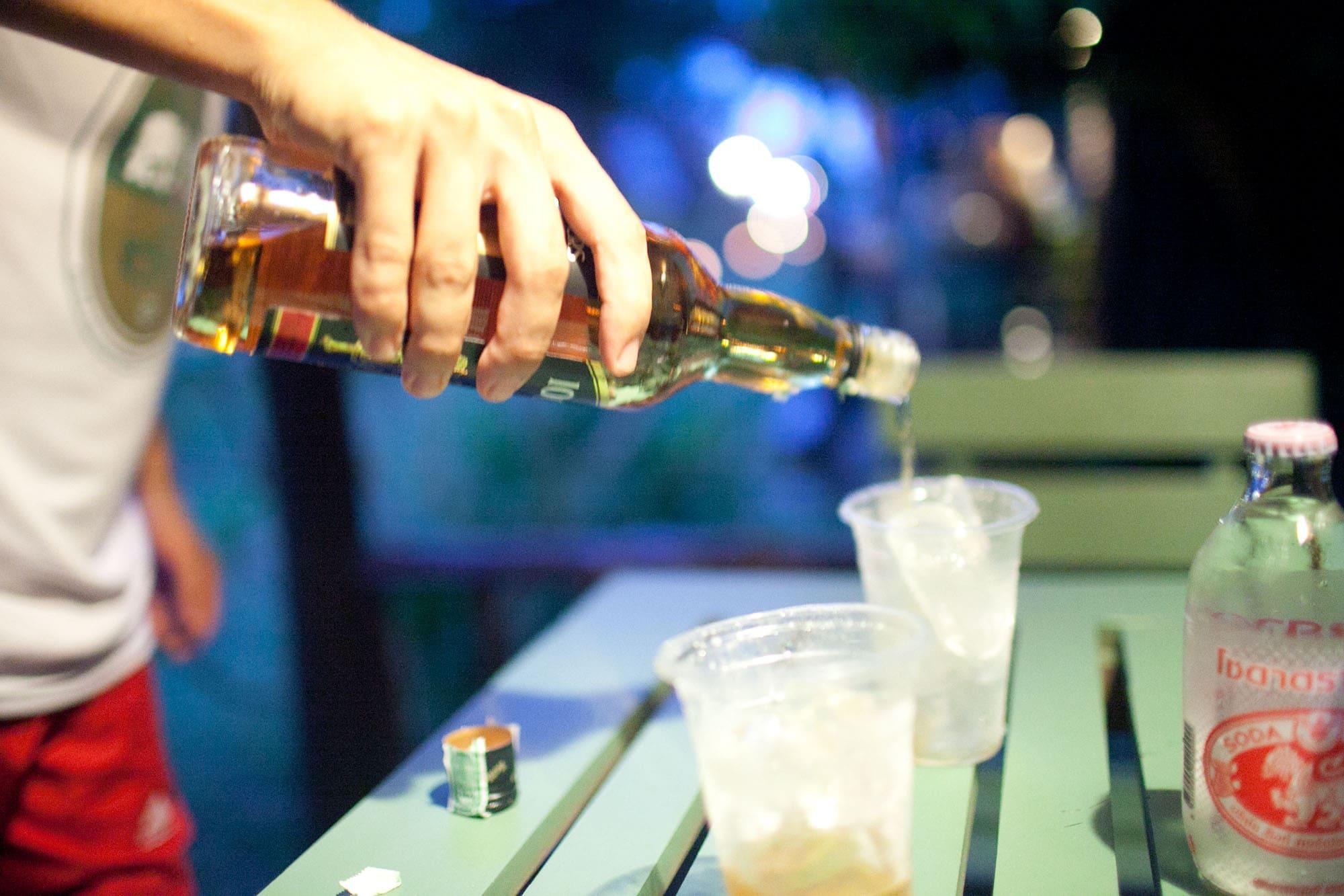 Pouring drinks in Koh Lanta, Thailand