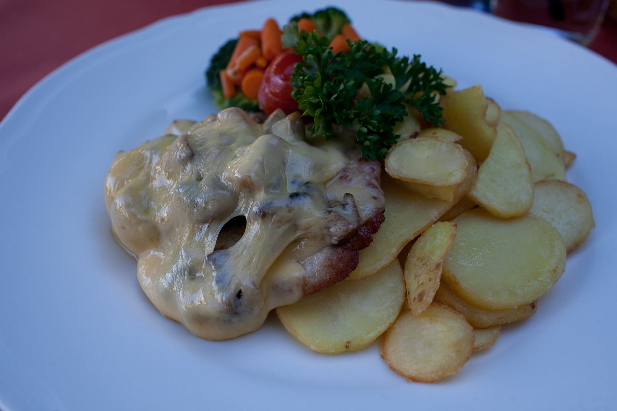 Pork cutlet with mushrooms and cheese in Krakow, Poland.