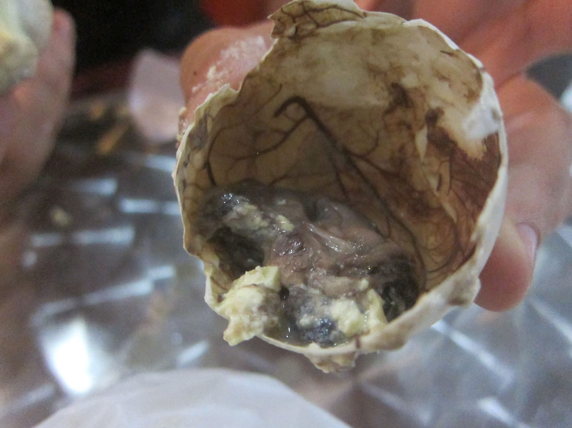 Eating Balut - fertilized duck embryo - in Manila, Philippines