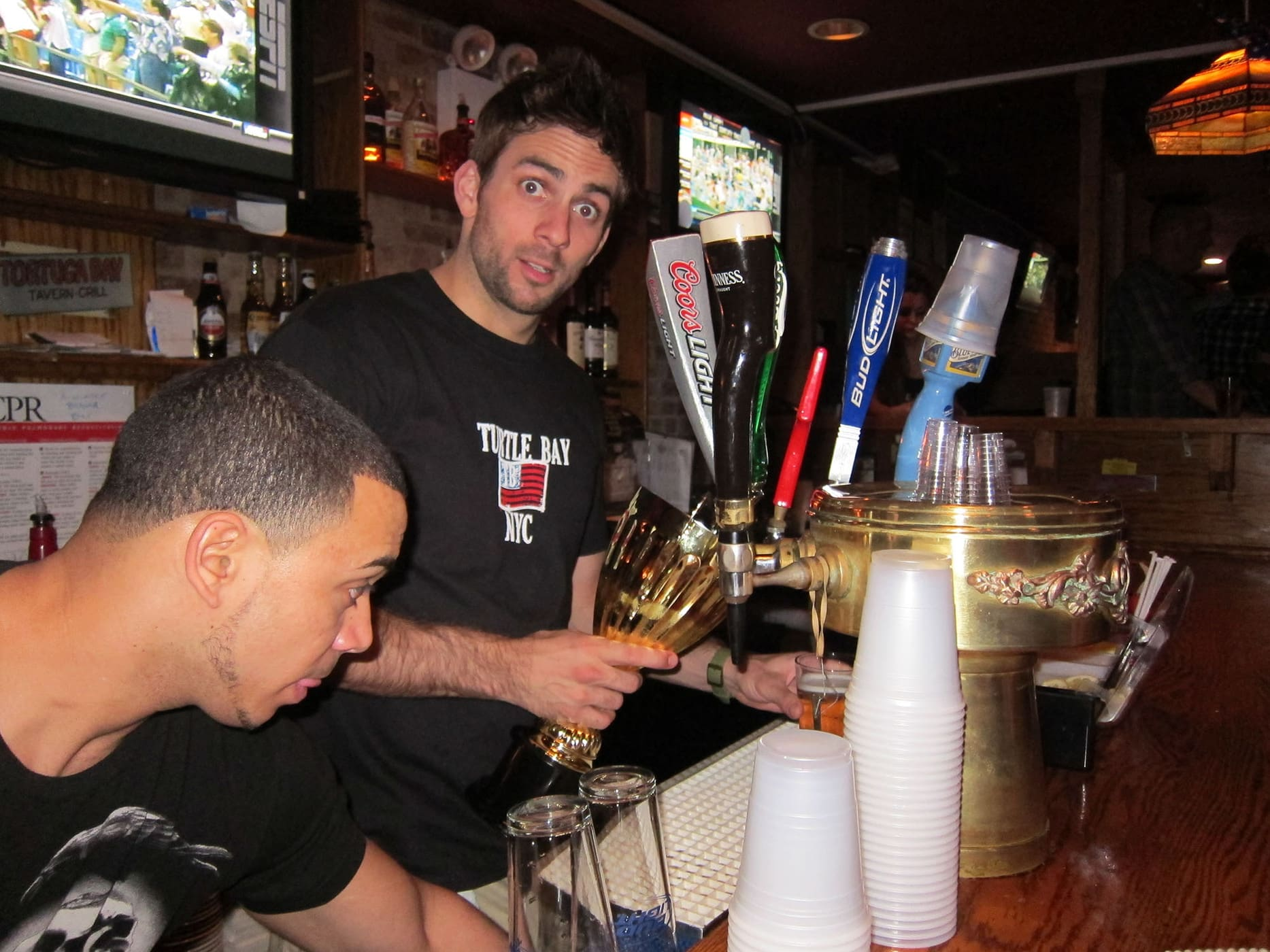 Pouring beer into the rookie of the year trophy