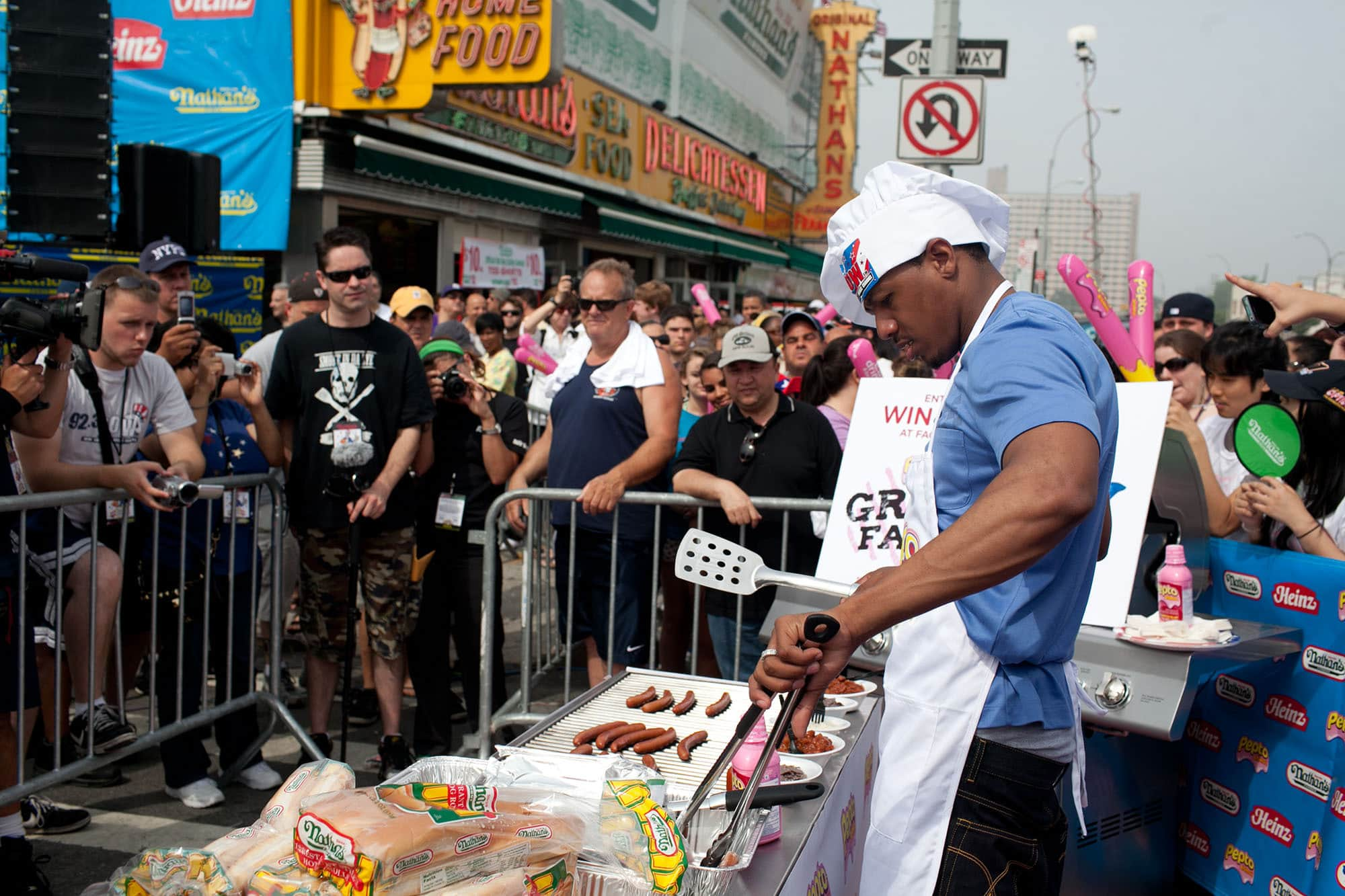 Nick Cannon at the grill for the hot dog eating contest