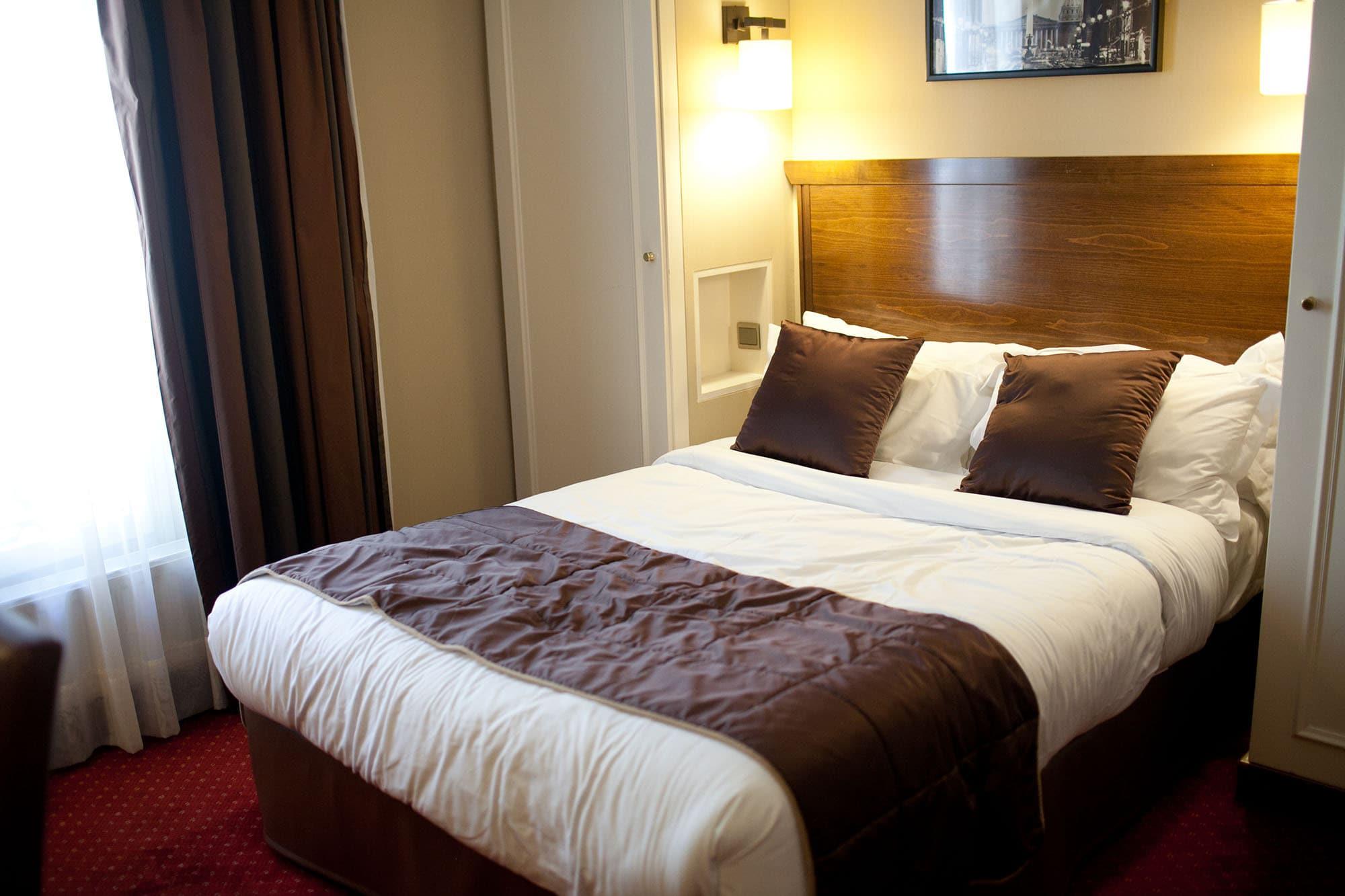 Big bed in my Paris hotel room.
