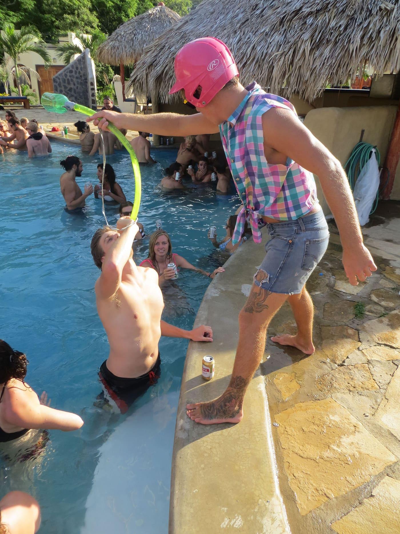 Beer bong at the Sunday Funday Pool Crawl in San Juan Del Sur, Nicaragua